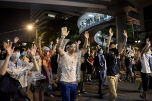 Pro-democracy protesters put their hands up in the air in front of the police in Hong Kong on September 28, 2014. Police fired tear gas as tens of thousands of pro-democracy demonstrators. (Alex Ogle/AFP/Getty Images)