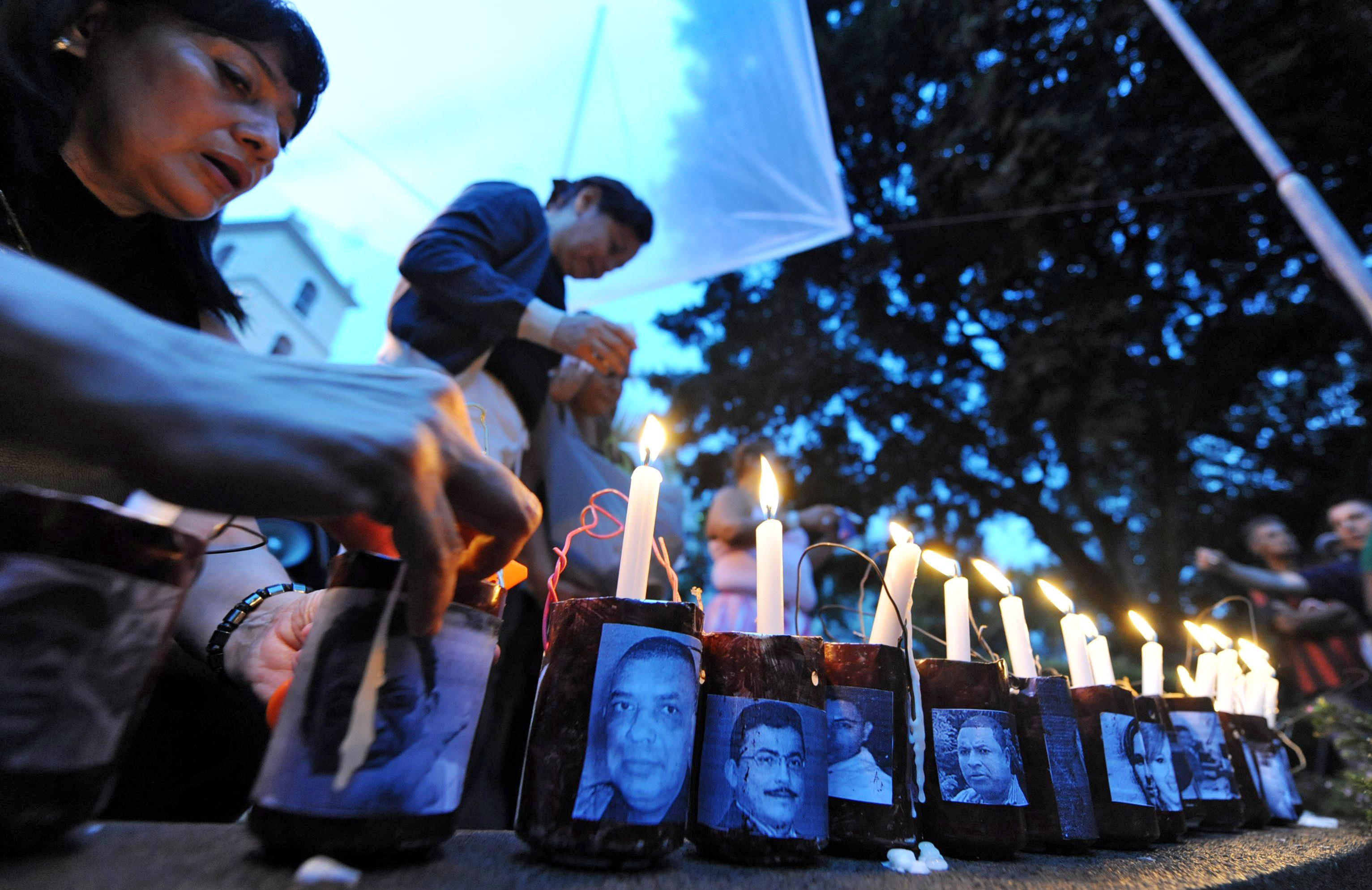 Honduran journalists take part in a vigil in memory of journalists killed in Honduras. (ORLANDO SIERRA/AFP/GettyImages)