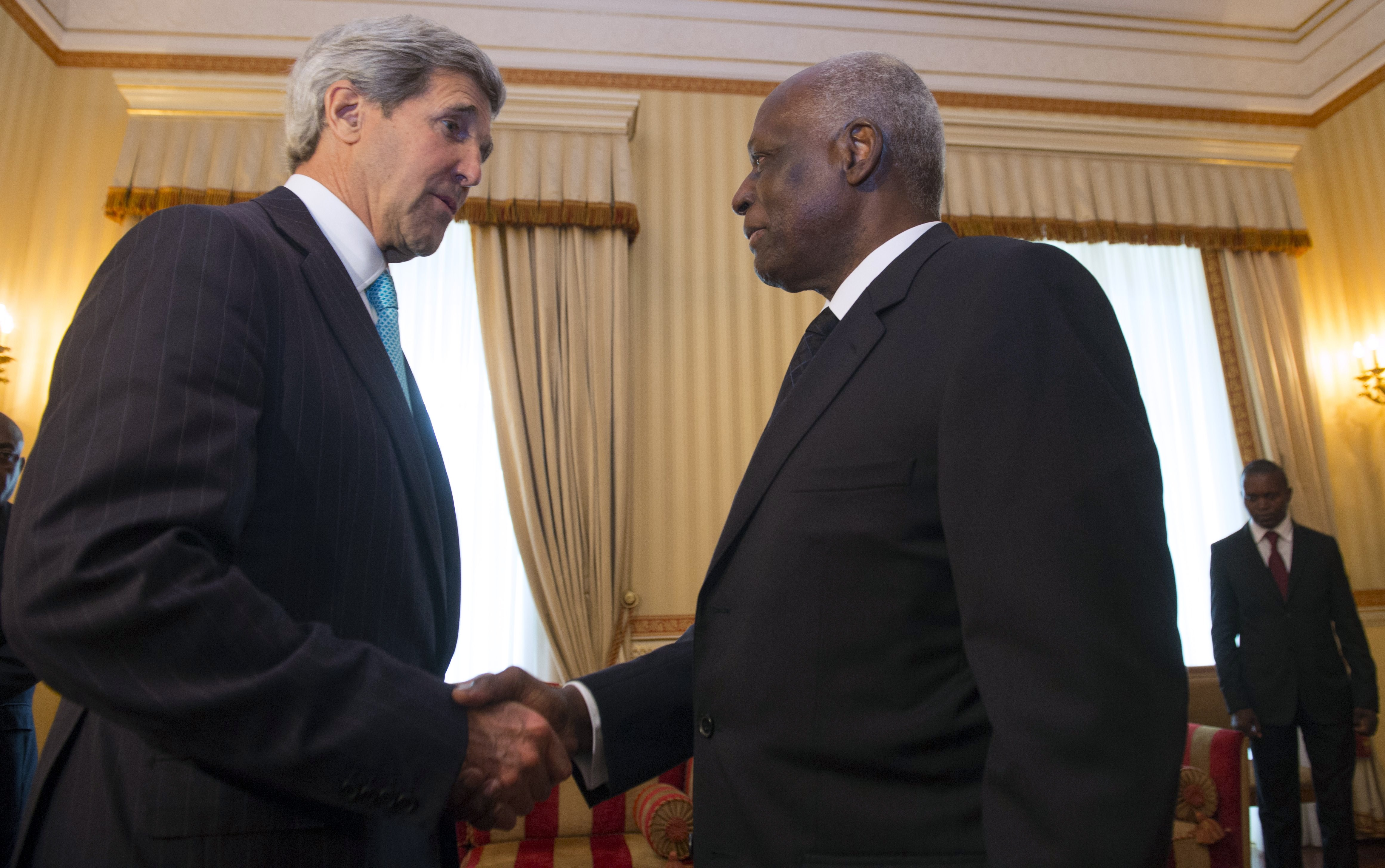 Angolan President Jose Eduardo dos Santos shakes hands with US Secretary of State John Kerry on May 5, 2014. SAUL LOEB/AFP/Getty Images