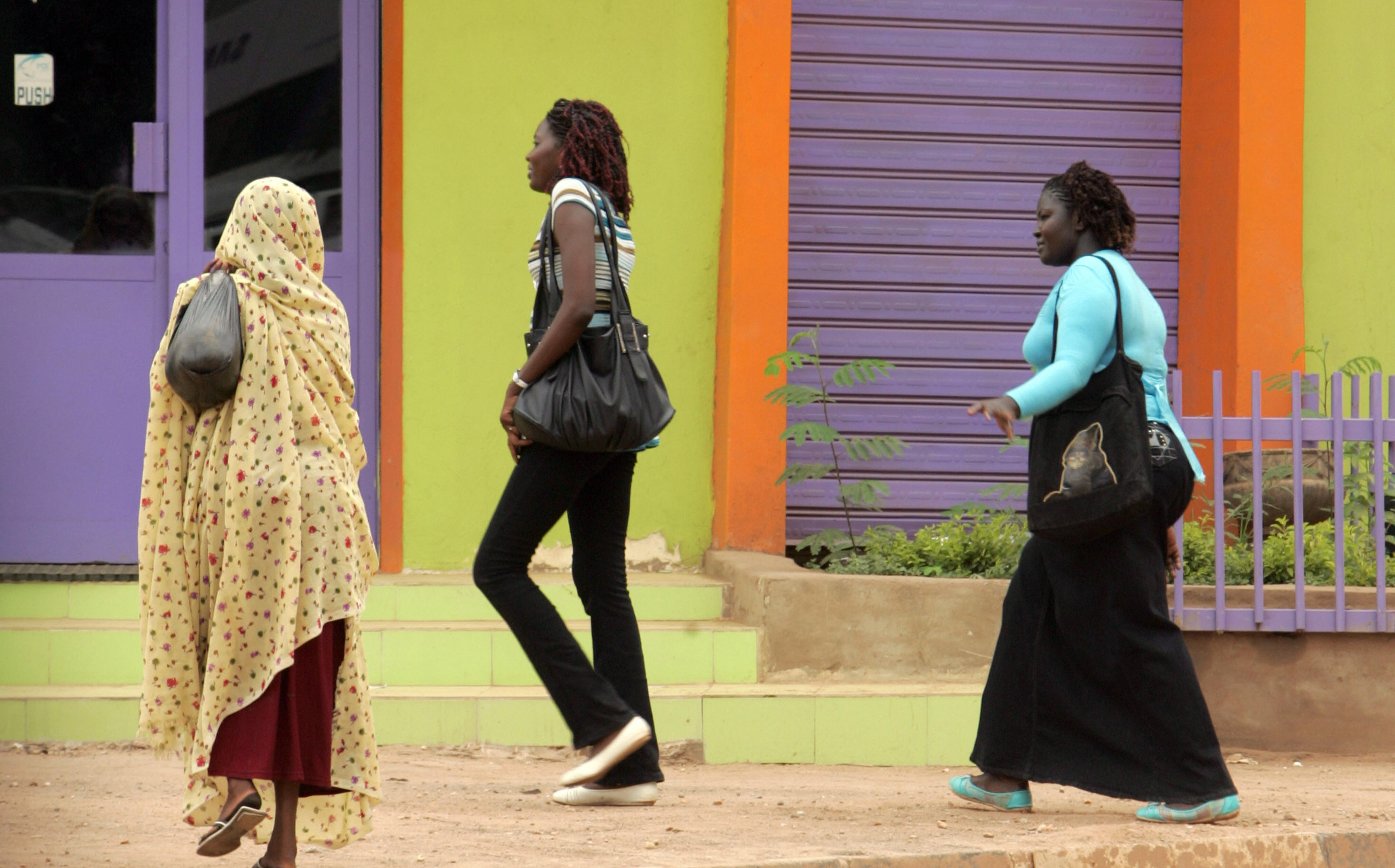 Three Sudanese women, one of them wearing trousers, walk on a main street in central Khartoum on September 8, 2009. The thousands of women who wear trousers every day all run the risk of a flogging if police decide their clothes are provocative. ASHRAF SHAZLY/AFP/Getty Images