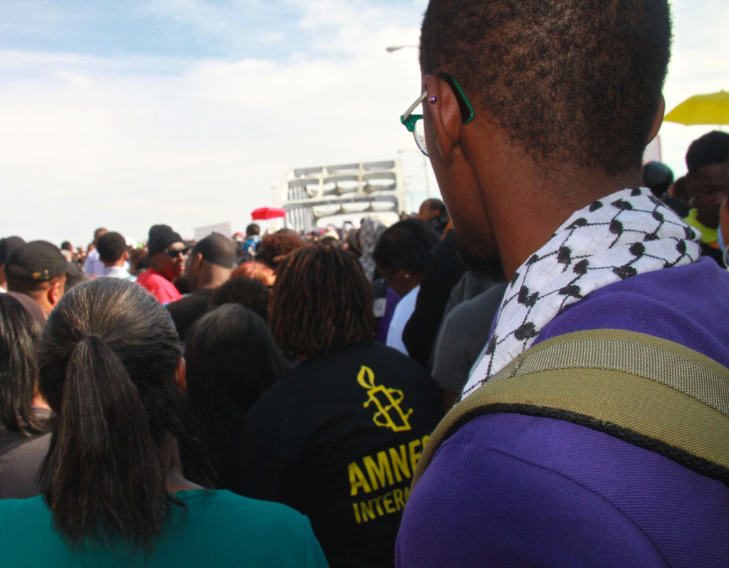 """Larry Fellows III (right) traveled to Selma, Alabama with Amnesty International USA for the 50th anniversary of """"Bloody Sunday.""""  (Photo: Amnesty International)"""