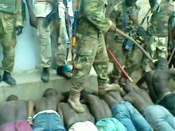 Images taken from a video of a 'screening' operation by the Nigerian military and Civilian Joint Task Force on 23 July 2013 in Bama town, Nigeria. More than 300 men were passed in front of a hidden informant. Up to 35 men were arrested on suspicion of being Boko Haram members.