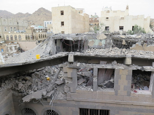 Destroyed home of al-Akwa family in which five civilians were killed in two consecutive airstrikes on 13 June 2015. (Credit: Amnesty International)