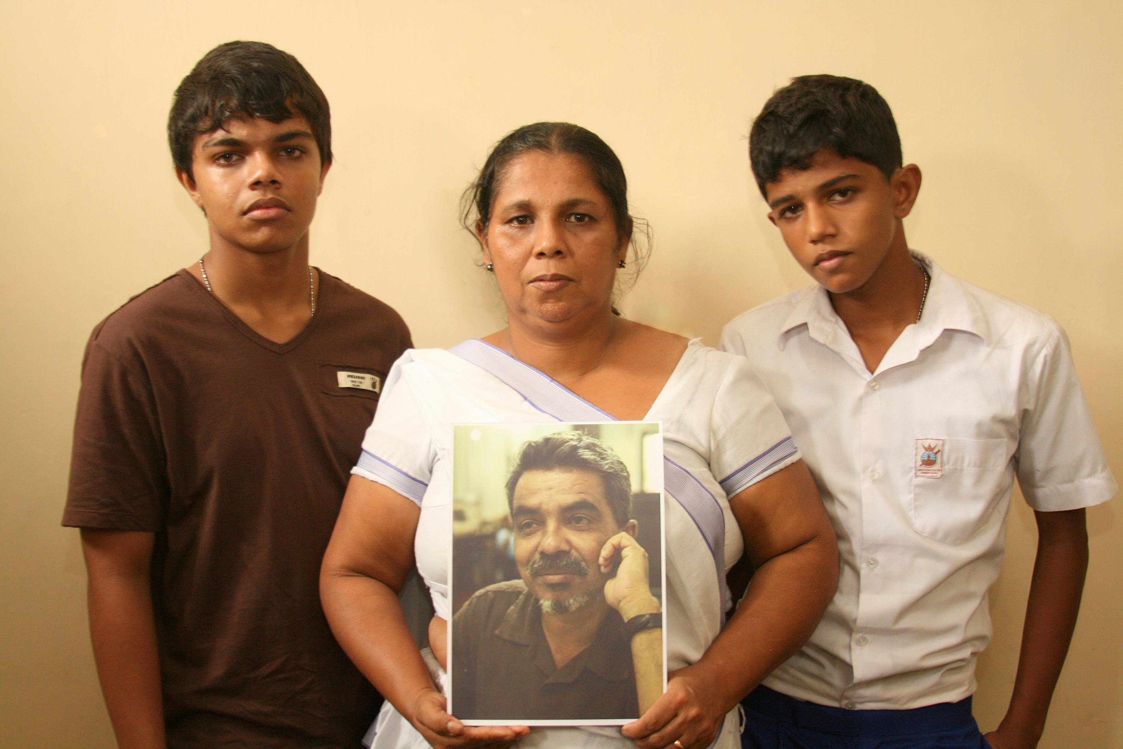 Sandya Eknaligoda wife of disappeared journalist Prageeth Eknaligoda with with their two sons Sathyajith Sanjaya and Harith Danajaya