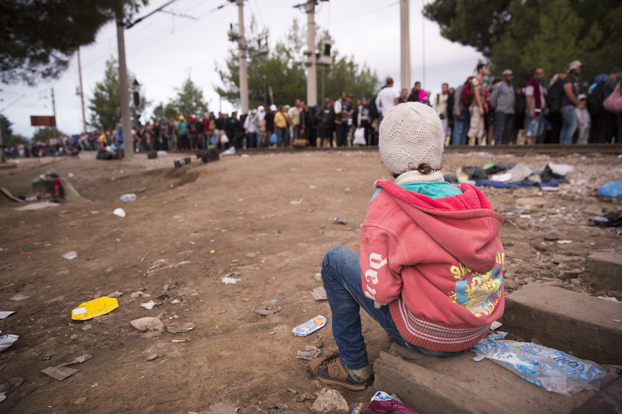 Refugees and migrants wait at the Macedonia border near the village of Idomeni, Greece, 24 August 2015.