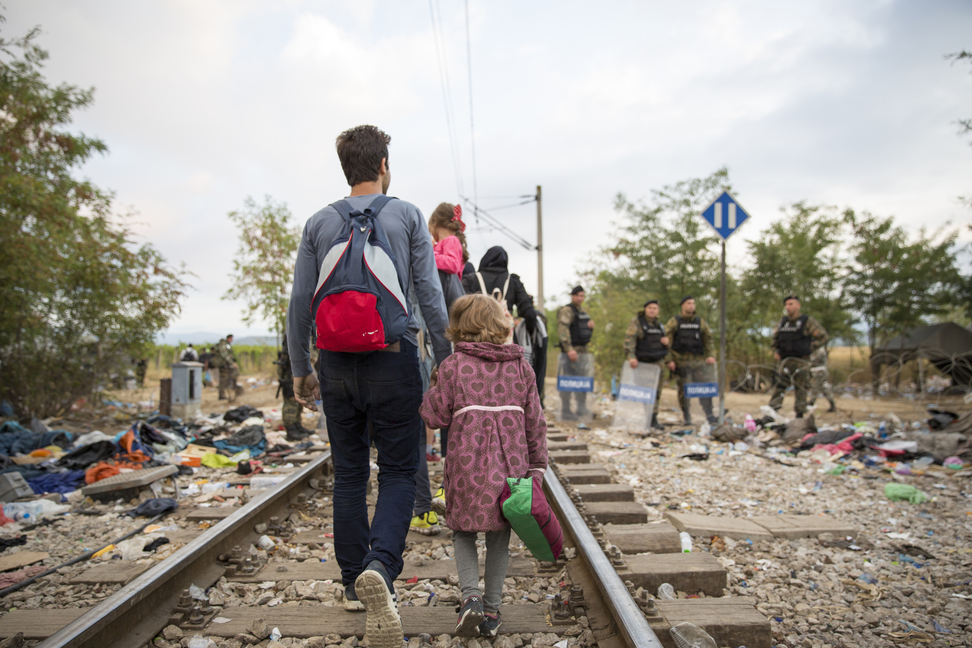 Refugees and migrants cross the border from Greece into Macedonia, 24 August 2015.