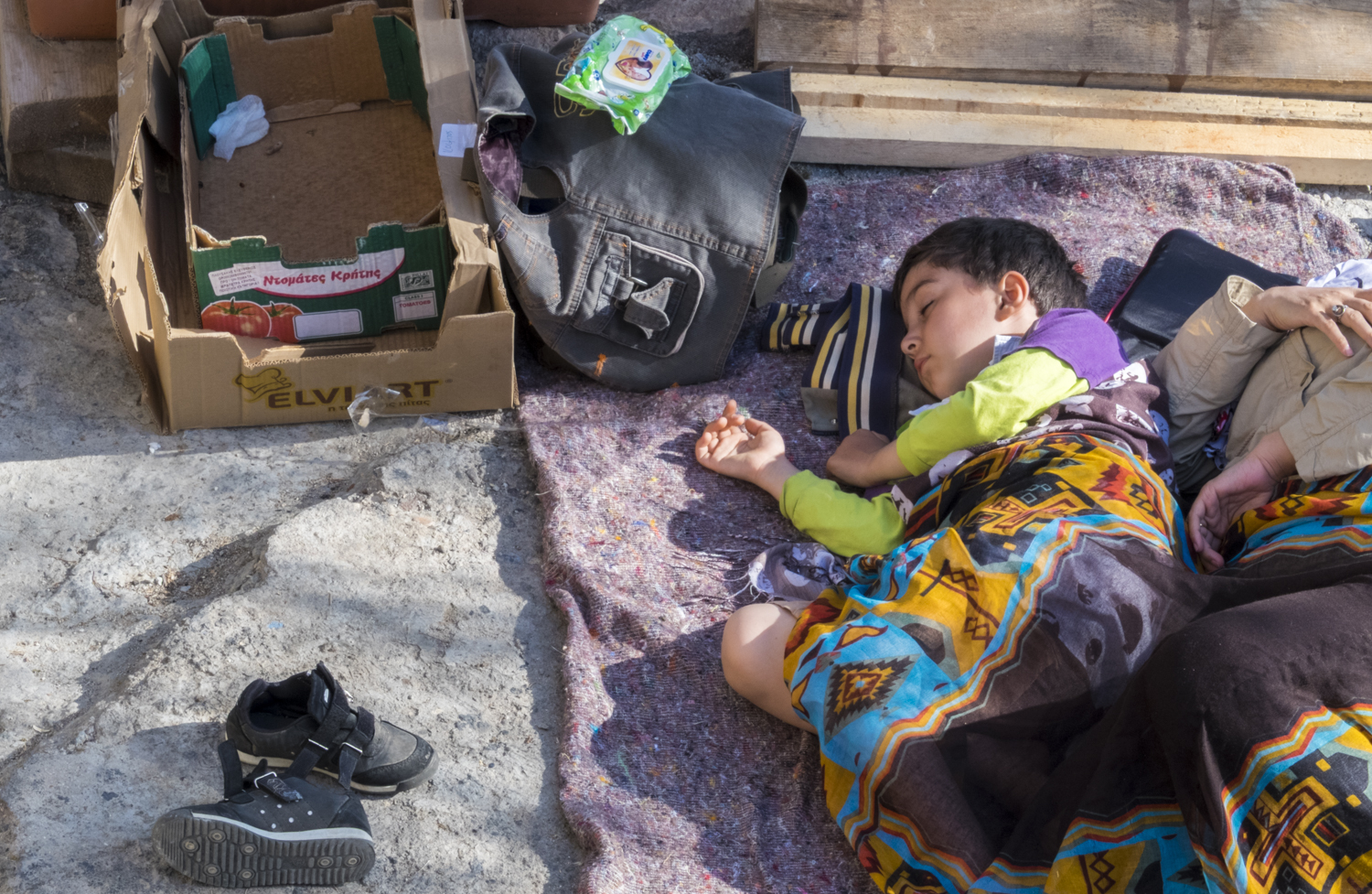 Child sleeping in a makeshift outdoor camp on the Greek island of Lesvos, 2015. © Michael S Honegger