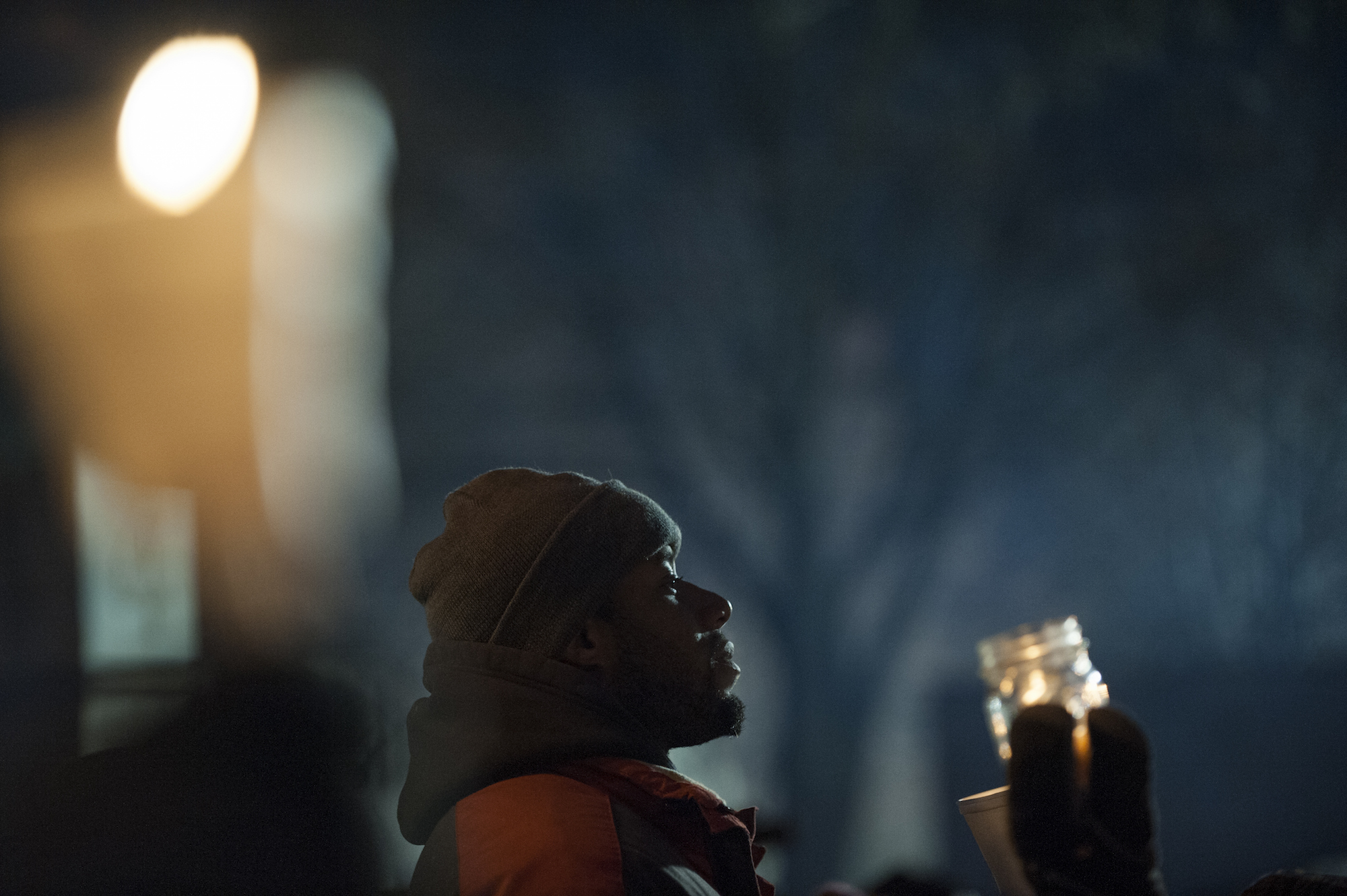 Protestors, activists, and community members listen to speeches at a candlelight vigil held for Jamar Clark on November 20 in Minneapolis, Minnesota. (Stephen Maturen/Getty Images)