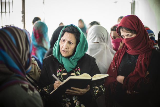 Fawzia Nawabi, investigator at the Afghanistan Independent Human Rights Commission, Mazar-e-Sharif, gathers information in a local women's prison.