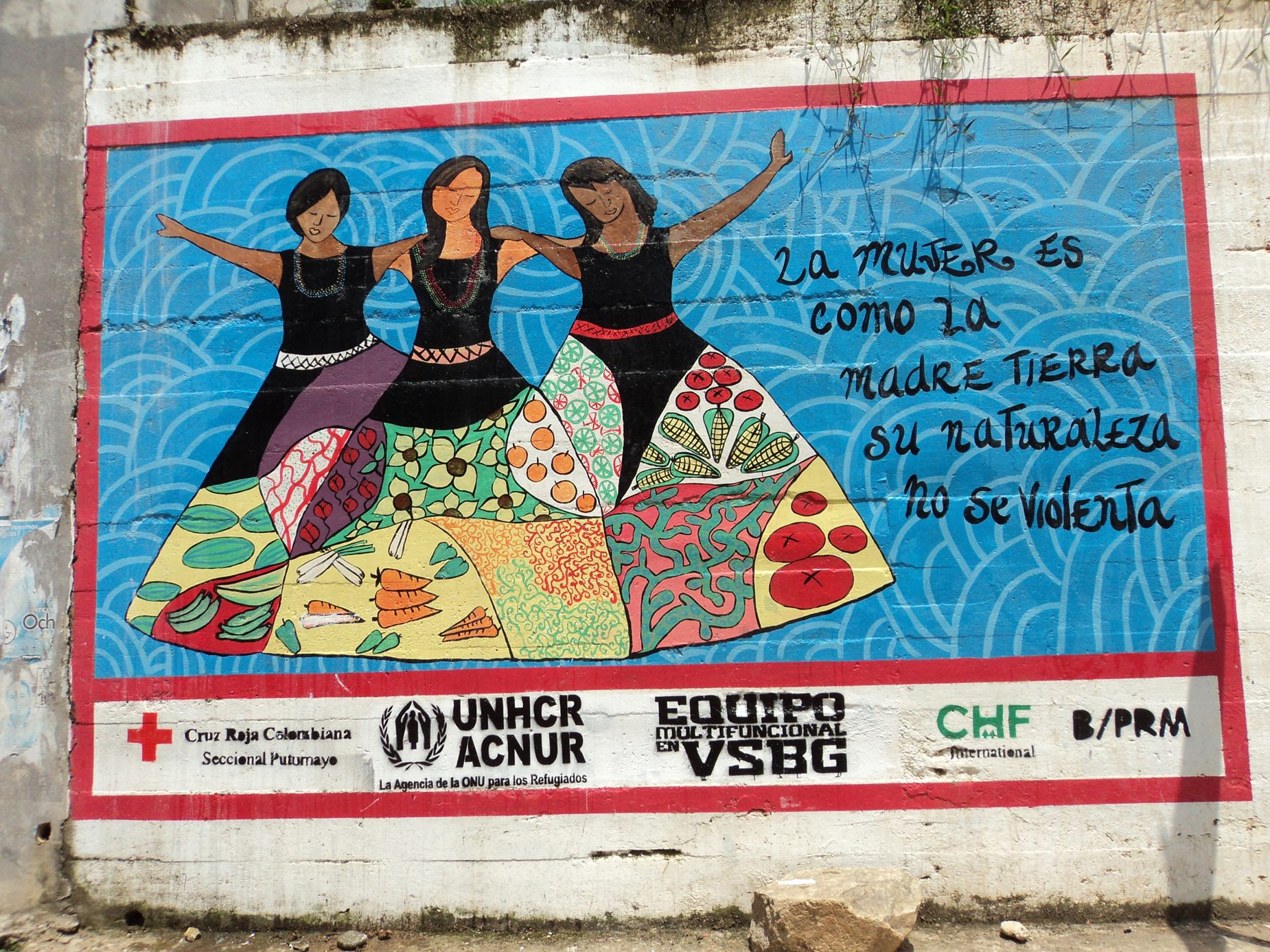 "A colourful awareness mural on the streets of Mocoa bears the message: ""Woman is like Mother Earth. Her nature must not be violated."""