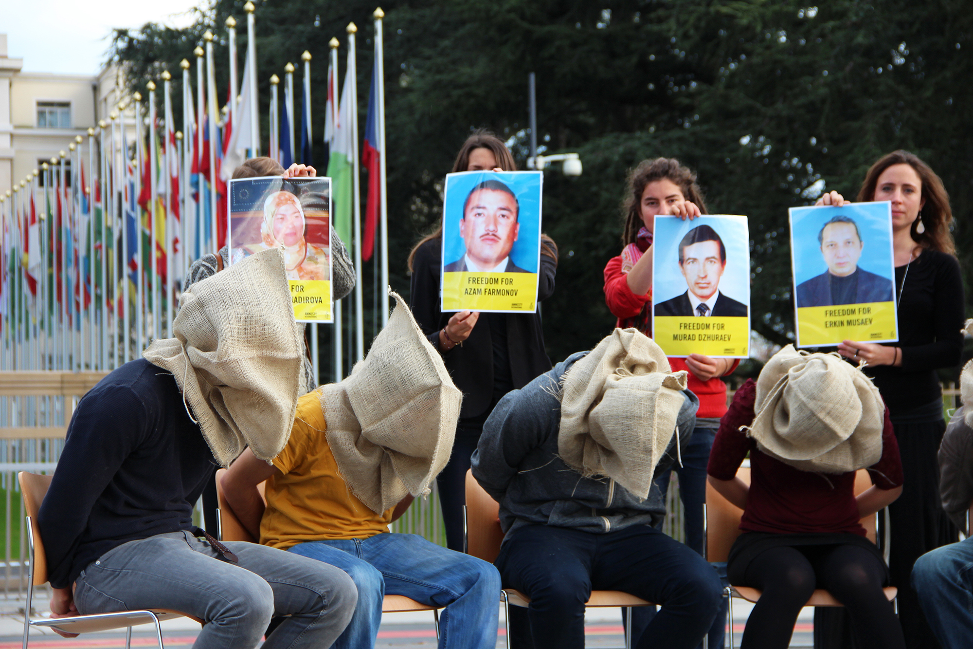 Activists of AI Switzerland bringing attention to human rights violations in Uzbekistan, demanding the release of Dilorom Abdukadirova, Azam Farmonov, Murad Dzhuraev and Erkin Musaev. Picture taken in front of the United Nations office in Geneva, Switzerland, October 21 2014