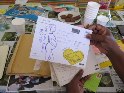 Solidarity messages from W4R 2014 are delivered to inhabitants of Mkhondo, Mpumalanga, South Africa. This card shows a drawing of a pregnant woman and the message - we will fight for you.