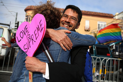 Same-sex marriage supporter Stuart Gaffney hugs a friend while celebrating the U.S Supreme Court ruling regarding same-sex marriage. (Photo by Justin Sullivan/Getty Images)