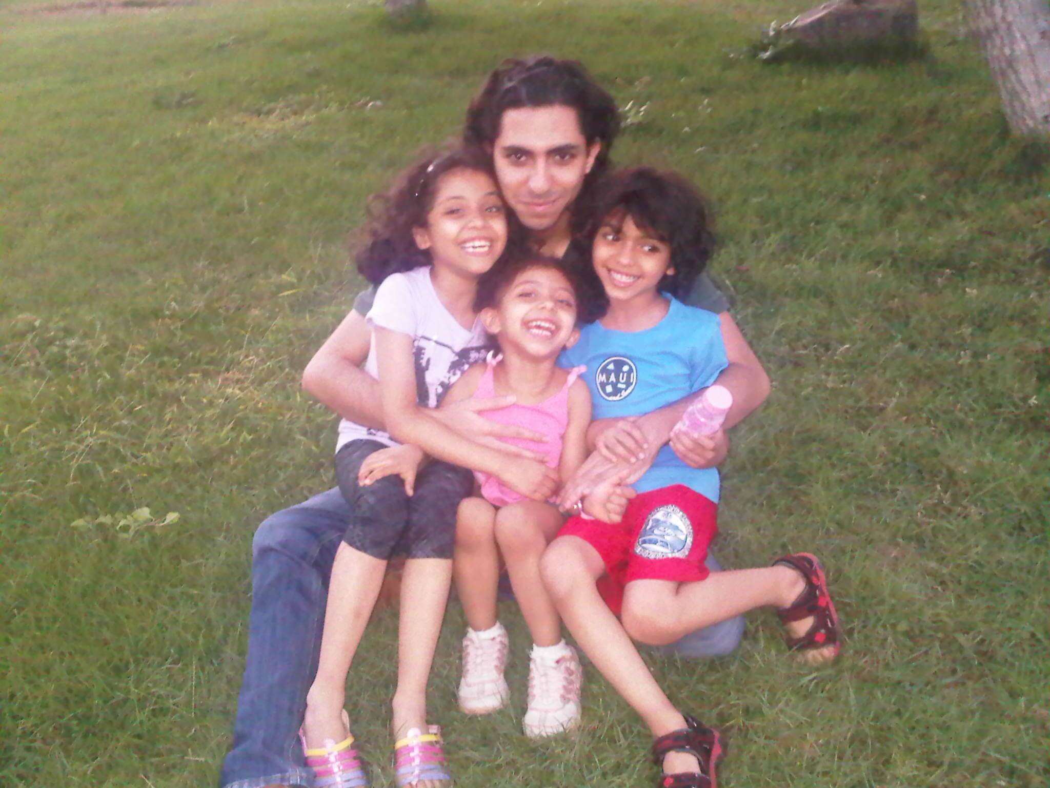 Raif Badawi with his kids.