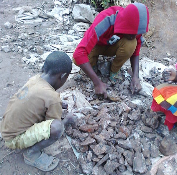 Children sorting and crushing cobalt ore in the neighbourhood of Kasulo, Kolwezi, DRC