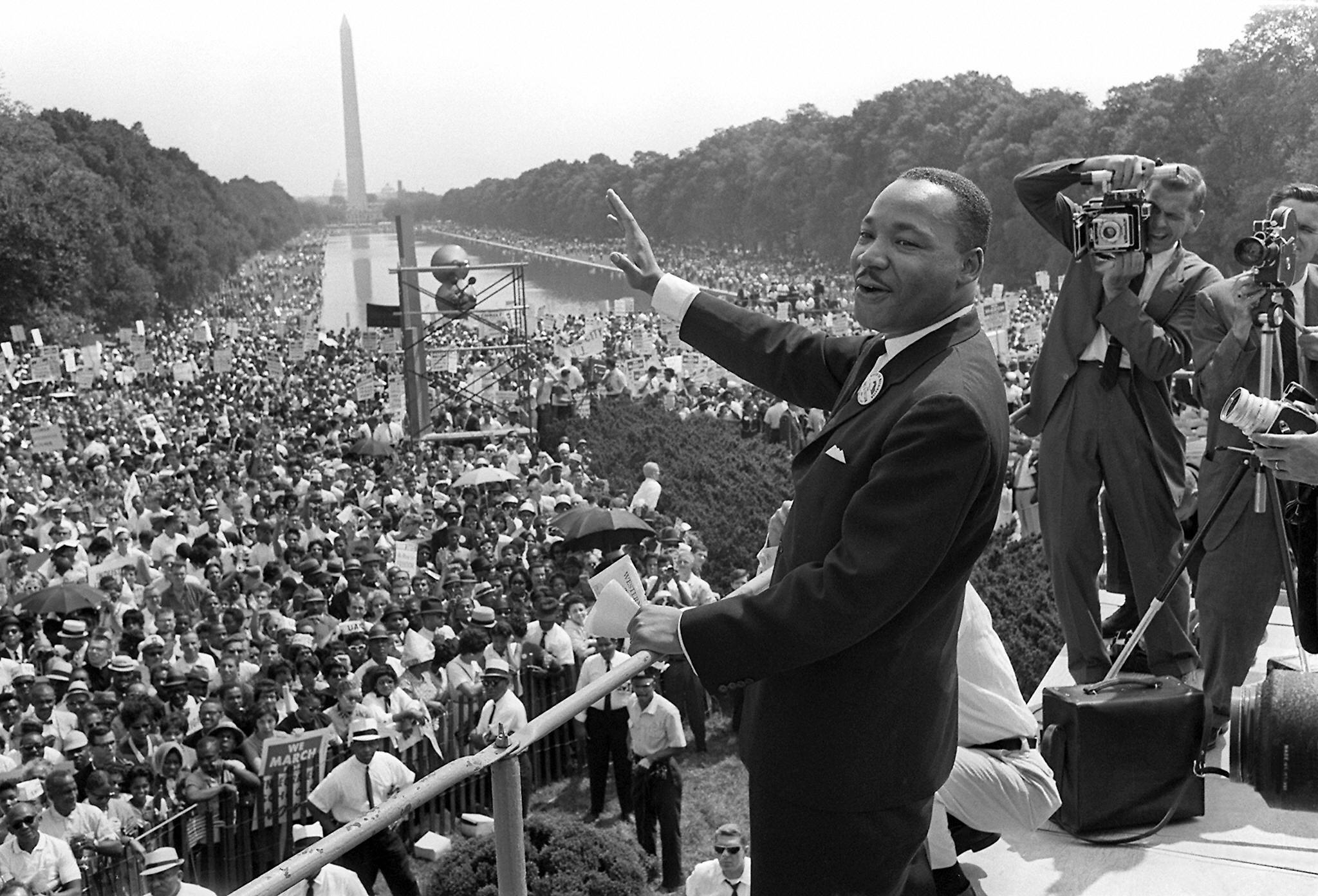 Martin Luther King, Jr. waves to supporters from the steps of the Lincoln Memorial 28 August 1963 on the Mall in Washington DC (AFP/Getty Images)
