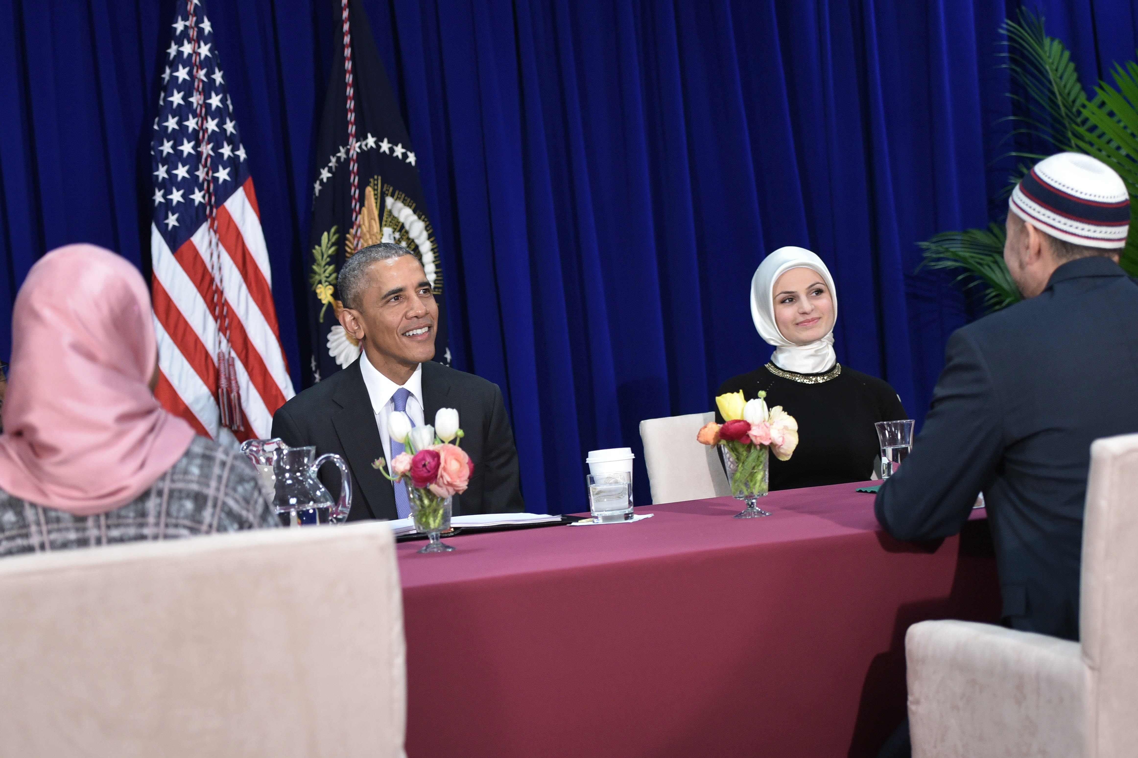 US President Barack Obama participates in a roundtable discussion with members of the Muslim community while visiting the Islamic Society of Baltimore February 3, 2016 in Windsor Mill, Maryland.  Seven years into his presidency, Barack Obama made his first trip to an American mosque on February 4, offering a high-profile rebuttal of harsh Republican election-year rhetoric against Muslims.   / AFP / MANDEL NGAN        (Photo credit should read MANDEL NGAN/AFP/Getty Images)