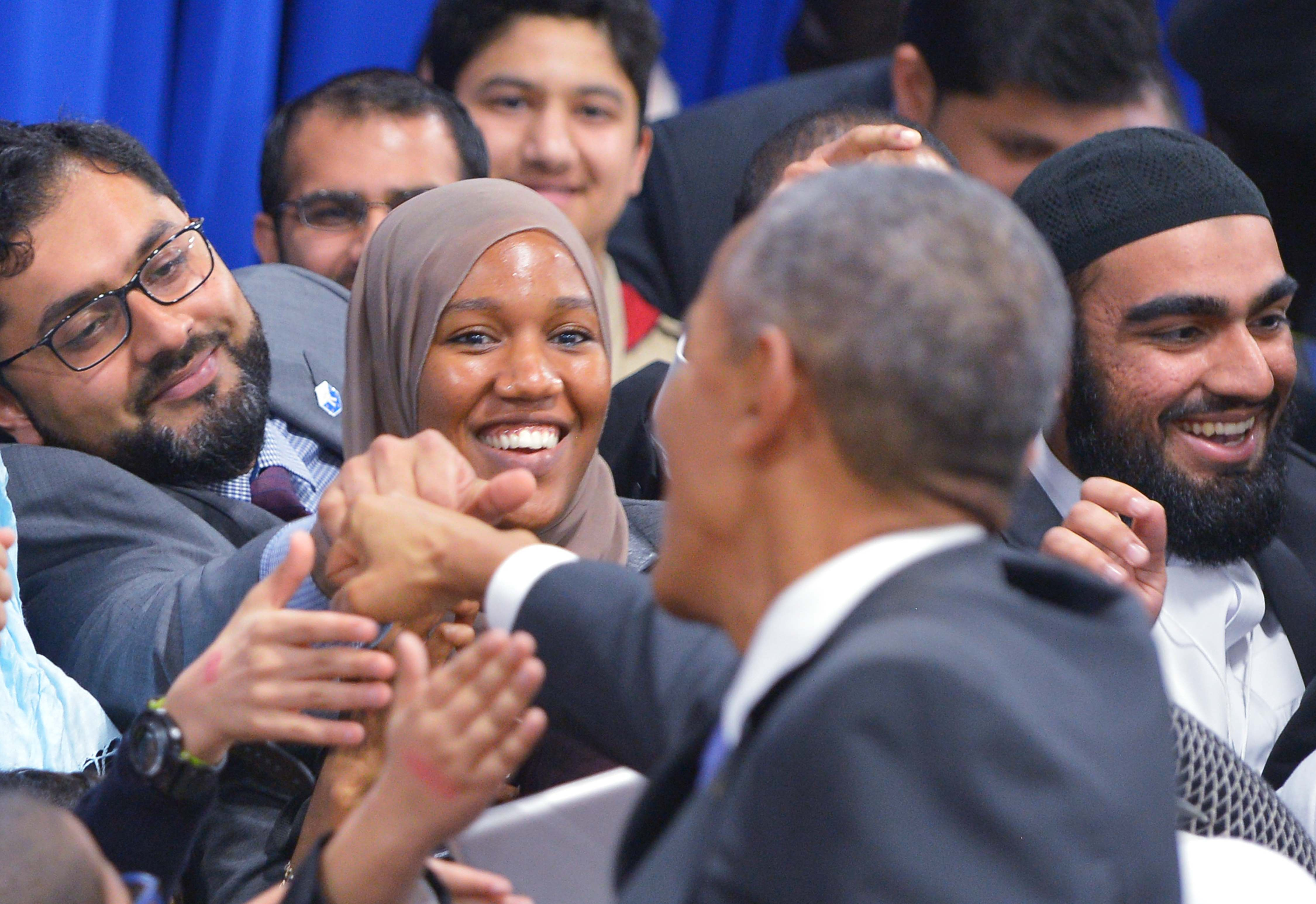 US President Barack Obama greets attendees in an overflow room after speaking at the Islamic Society of Baltimore, in Windsor Mill, Maryland,on February 3, 2016. / AFP / MANDEL NGAN        (Photo credit should read MANDEL NGAN/AFP/Getty Images)