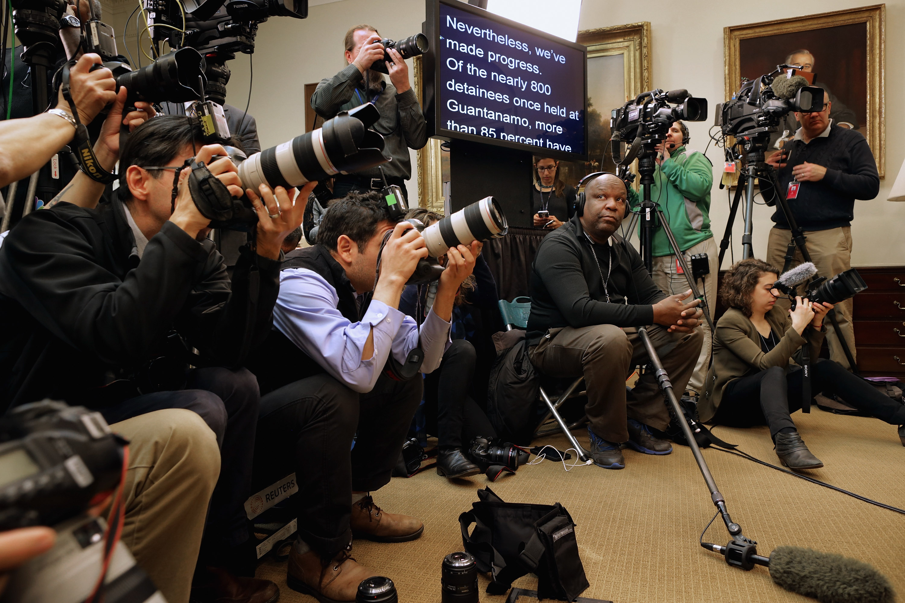 WASHINGTON, DC - FEBRUARY 23:  Journalists cover President Barack Obama making a statement about his plan to close the detention camp at the Guantanamo Bay Naval Base and relocate the terrorism suspects there to the United States in the Roosevelt Room at the White House February 23, 2016 in Washington, DC. Attempting to follow through with a campaign pledge he made in 2008, Obama will continue to face an uphill battle to close the prison in Cuba because of strong opposition to the plan by congressional Republicans.  (Photo by Chip Somodevilla/Getty Images)