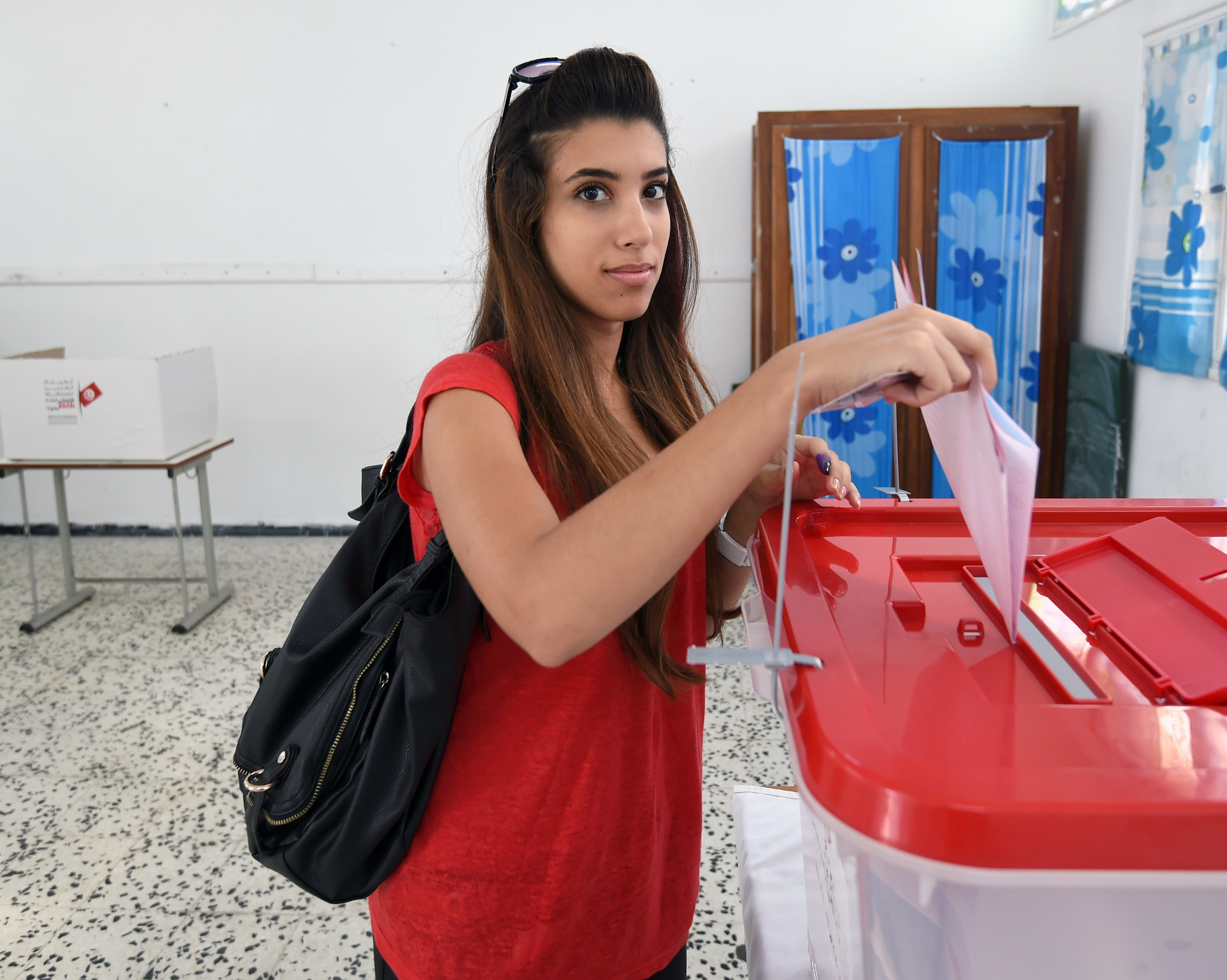 A Tunisian woman casts her vote in the country's first post-revolution parliamentary election on October 26, 2014 at El-Manzeh VI School turned into a polling station in the Tunis suburb of Ariana. Tunisians were voting in an election seen as pivotal to establishing democracy in the cradle of the Arab Spring uprisings, with security forces deploying heavily to avert extremist attacks. AFP PHOTO /  FETHI BELAID        (Photo credit should read FETHI BELAID/AFP/Getty Images)