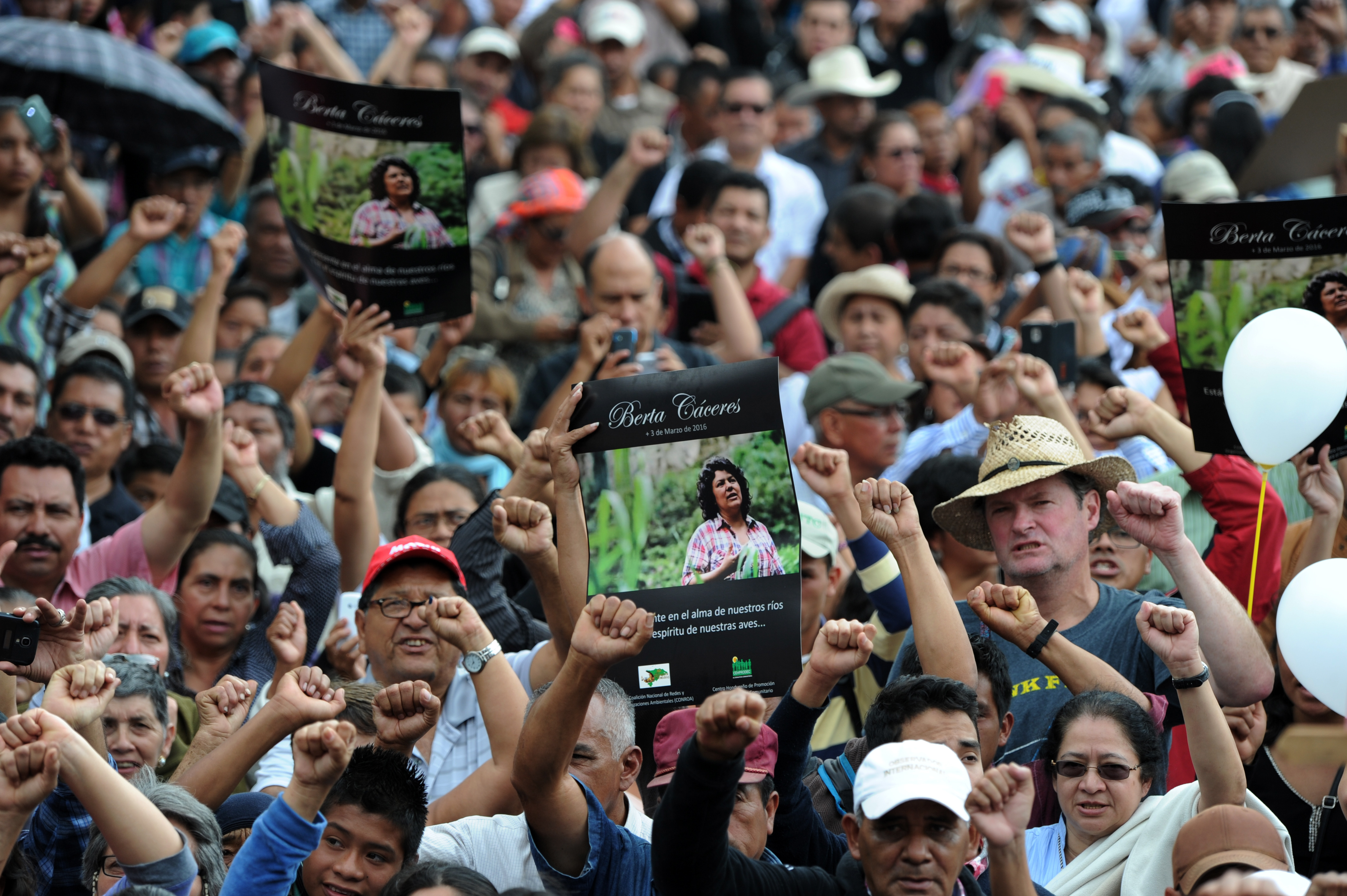 People attend the funeral of murdered indigenous activist Berta Caceres, in La Esperanza, 200 km northwest of Tegucigalpa, on March 5, 2016. Honduran indigenous activist Berta Caceres, a renowned environmentalist whose family has labeled her killing an assassination, was shot dead on March 3 at her home in La Esperanza. Caceres rose to prominence for leading the indigenous Lenca people in a struggle against a hydroelectric dam project that would have flooded large areas of native lands and cut off water supplies to hundreds.  AFP PHOTO / ORLANDO SIERRA / AFP / ORLANDO SIERRA        (Photo credit should read ORLANDO SIERRA/AFP/Getty Images)