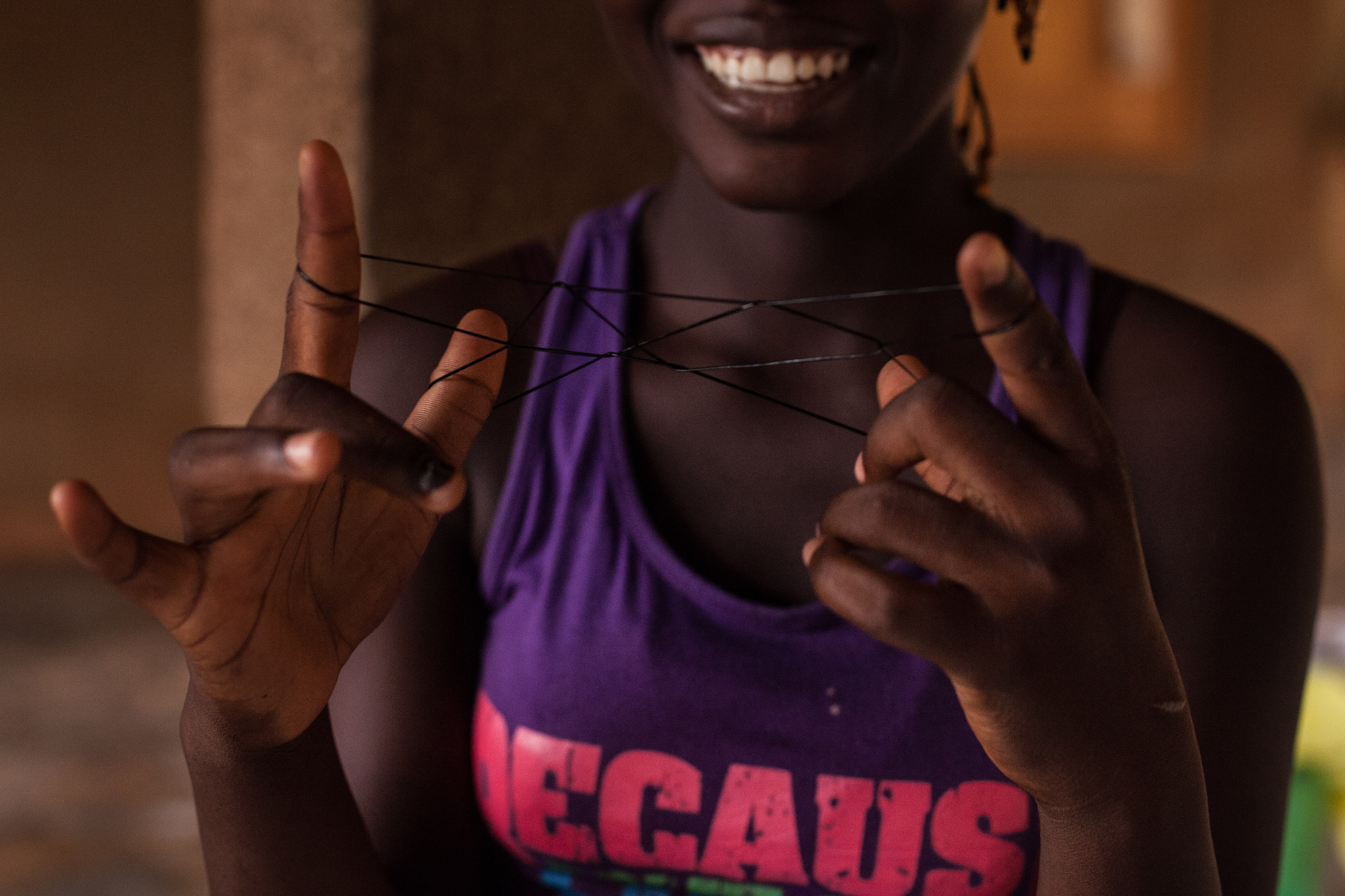 Playing with elastic bands – a typical game played by girls aged 7 to 12 in Burkina Faso. Girls relax and reconnect with their childhoods at Foceb shelter for survivors of rape, early and forced marriage and unwanted pregnancy in central Ouagadougou, capital of Burkina Faso. The shelter takes in girls aged as young as 12 to as old as 18. Between 2001 and 2009, the shelter accommodated a total of 209 girls and 168 children. In Burkina Faso, girls who get pregnant outside marriage are often rejected by their families. Places like Foceb give them the opportunity to rebuild their lives. In Burkina Faso, 52% of all girls are forced into marriage – the 7th highest rate for child marriage in the world.