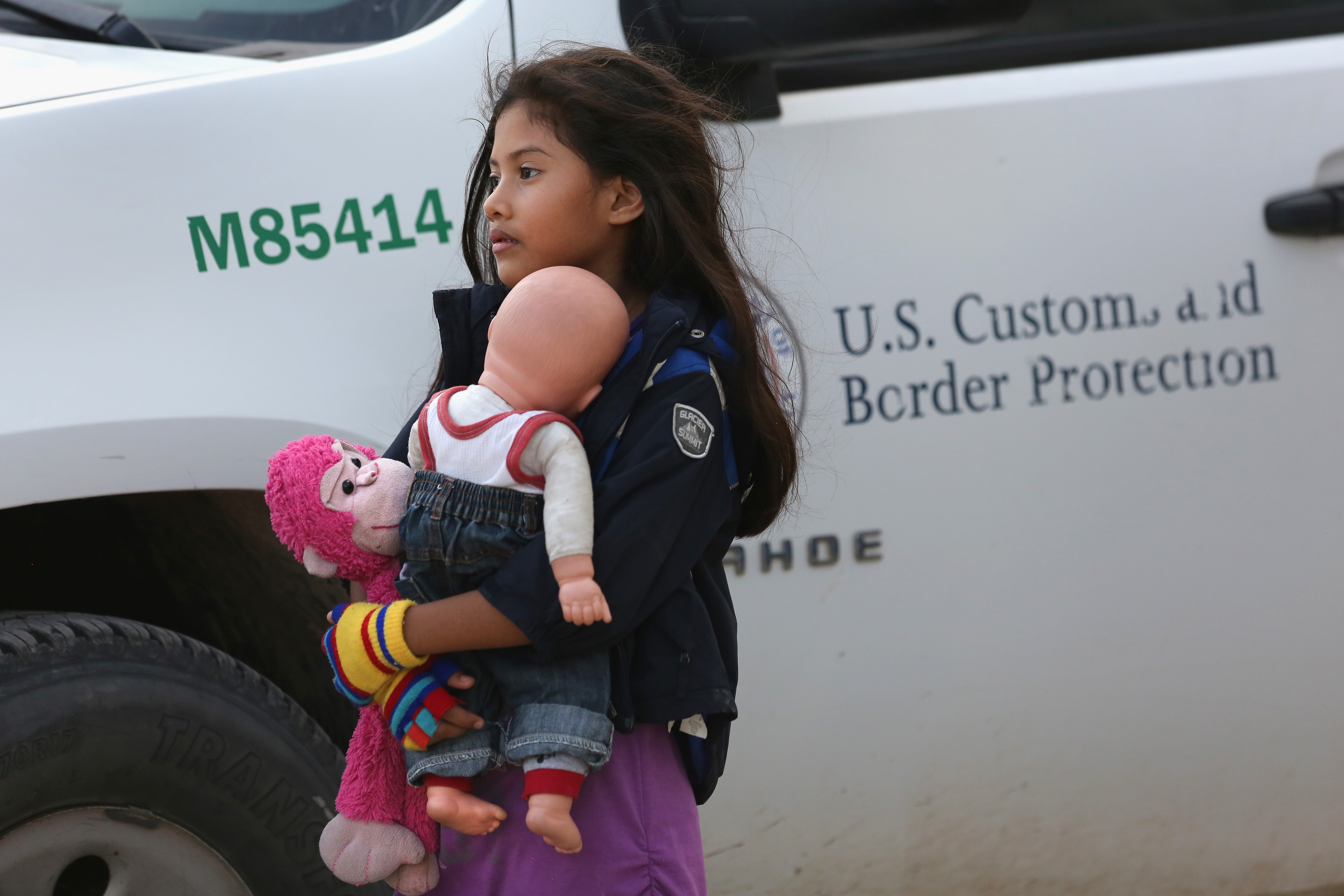 Salvadorian immigrant Stefany Marjorie, 8, holds her doll Rodrigo ( John Moore/Getty Images)