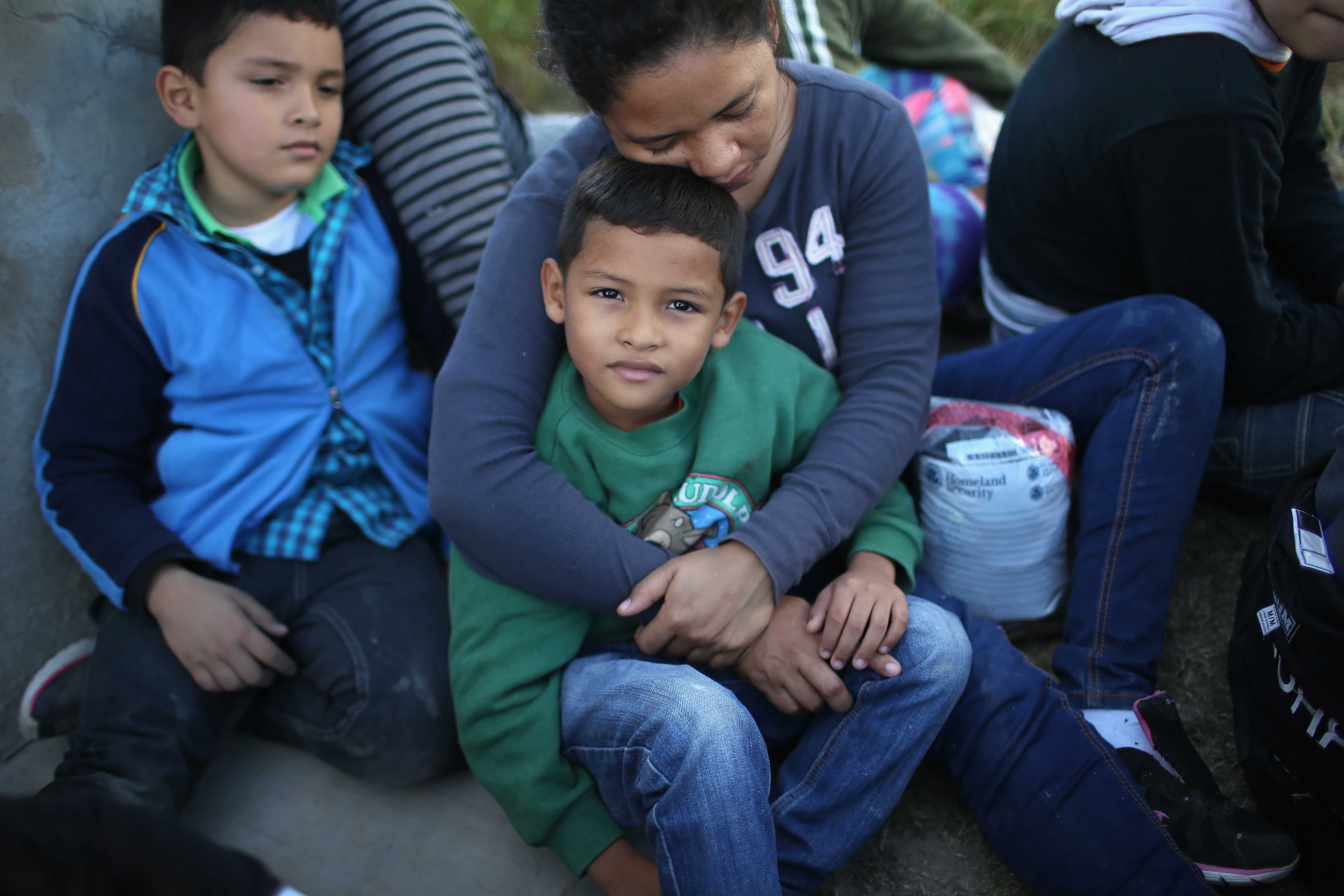 Honduran mother holds her son, 7 ( John Moore/Getty Images)