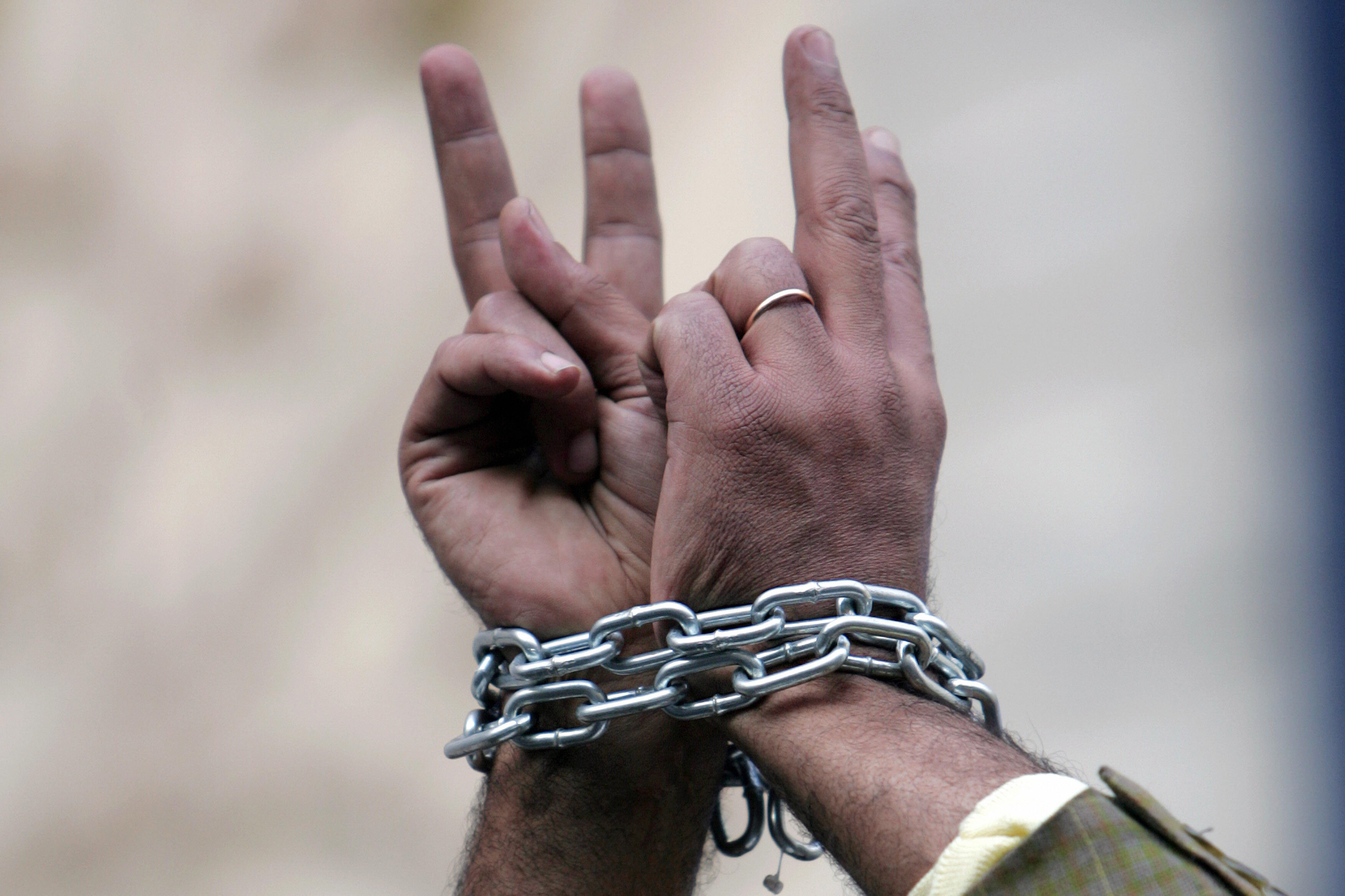 Egyptian human right activist with chained hands during a protest against torture in police stations. KHALED DESOUKI/AFP/Getty Images
