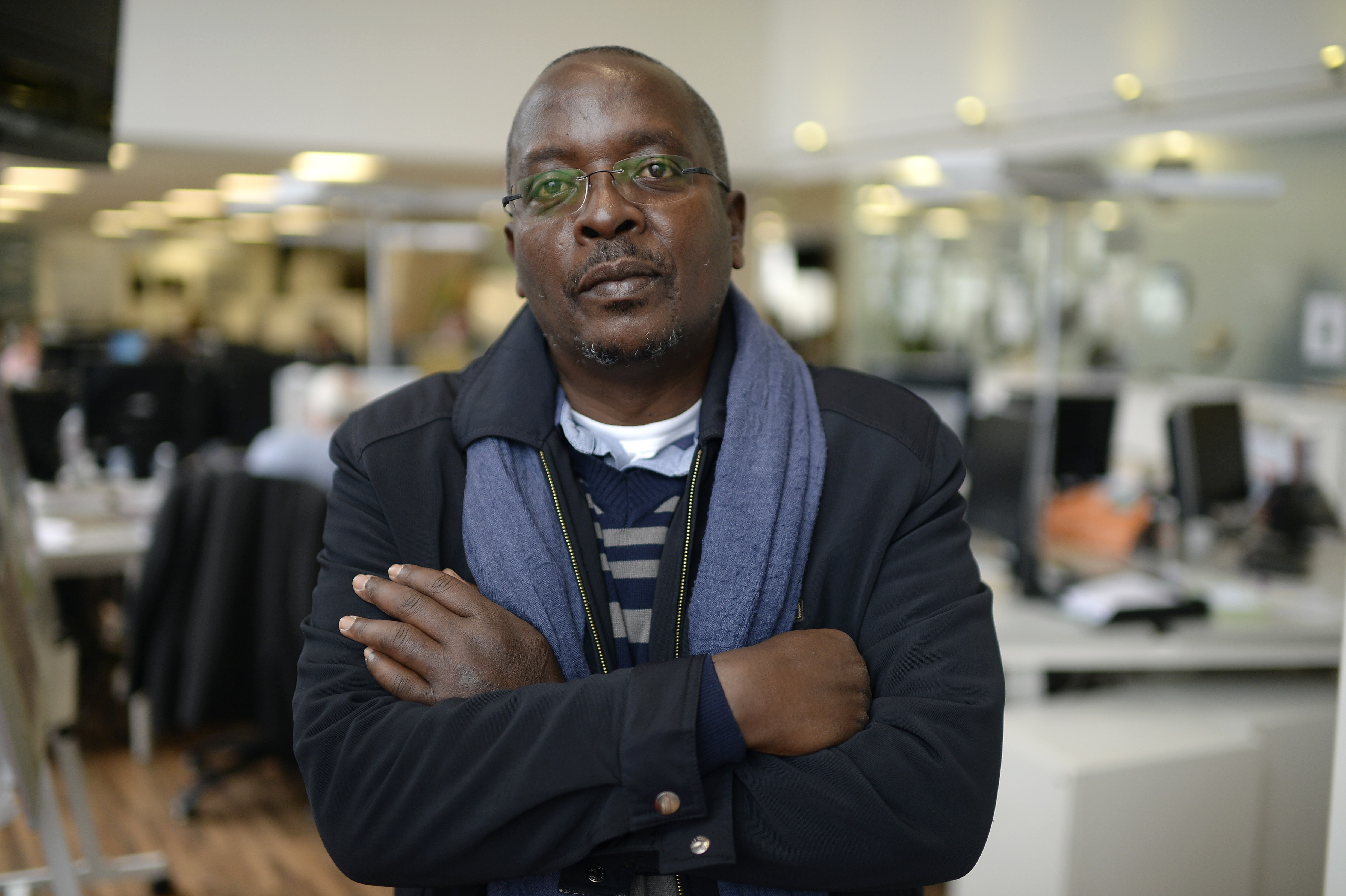Burundi-based AFP journalist Esdras Ndikumana poses at the Agence France-Presse (AFP) headquarters in Paris on October 19, 2015. Ndikumana, 54, was taking pictures at the scene of the assassination of a top general in the capital Bujumbura on August 2, when he was arrested by members of the National Intelligence Service (SNR). He was held for around two hours, during which he was subjected to severe beatings on his back, legs and the soles of his feet. AFP PHOTO / MIGUEL MEDINA        (Photo credit should read MIGUEL MEDINA/AFP/Getty Images)
