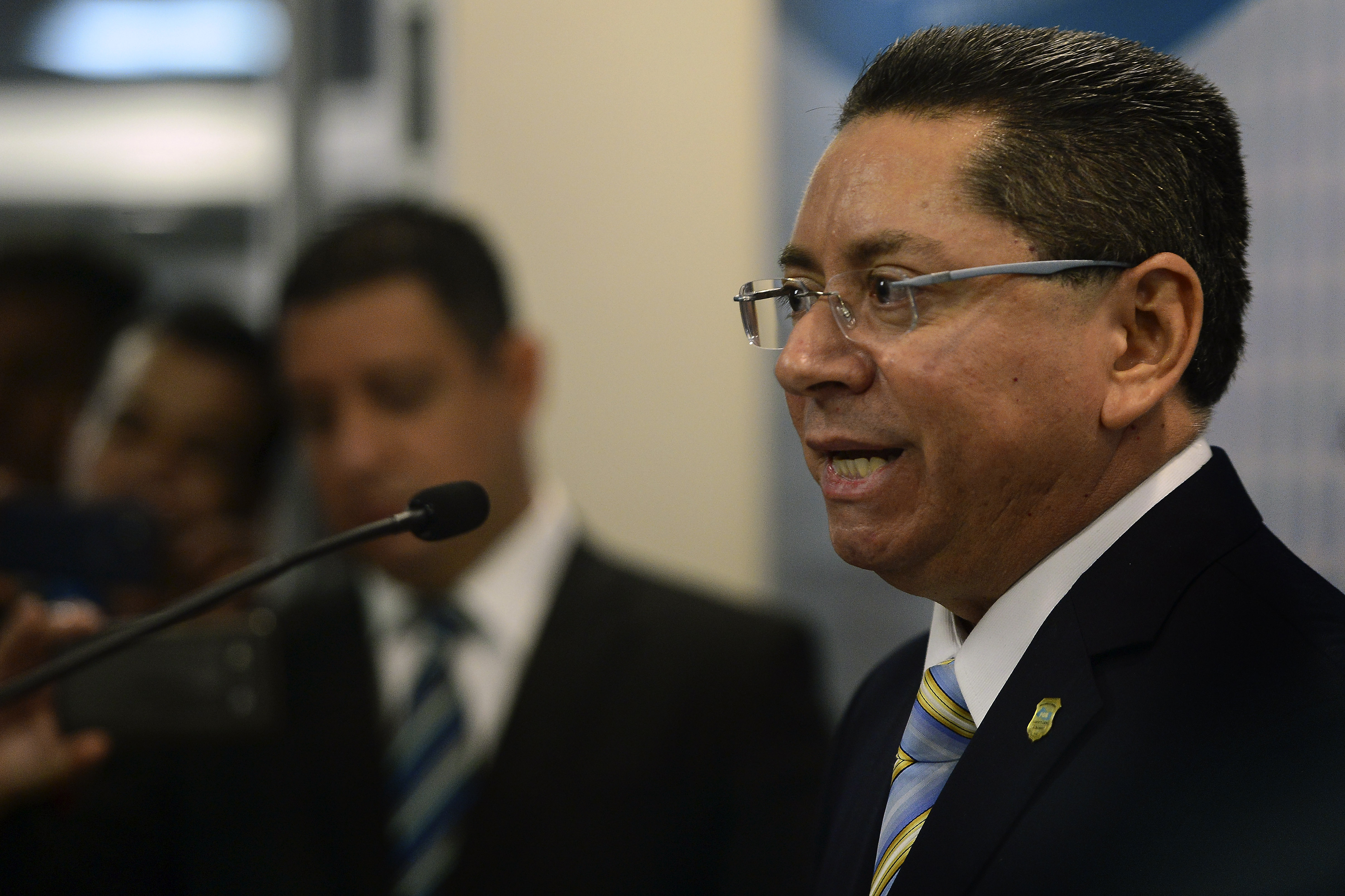 The new Prosecutor General of El Salvador, Douglas Arquimedes Melendez speaks during a press conference in San Salvador, on January 6, 2016. Melendez takes over as prosecutor general amid a social crisis provoked by an alarming increase in the number of murders, and which places Salvador as one of the most violent countries in Latin America.   AFP PHOTO / Marvin RECINOS / AFP / Marvin RECINOS        (Photo credit should read MARVIN RECINOS/AFP/Getty Images)