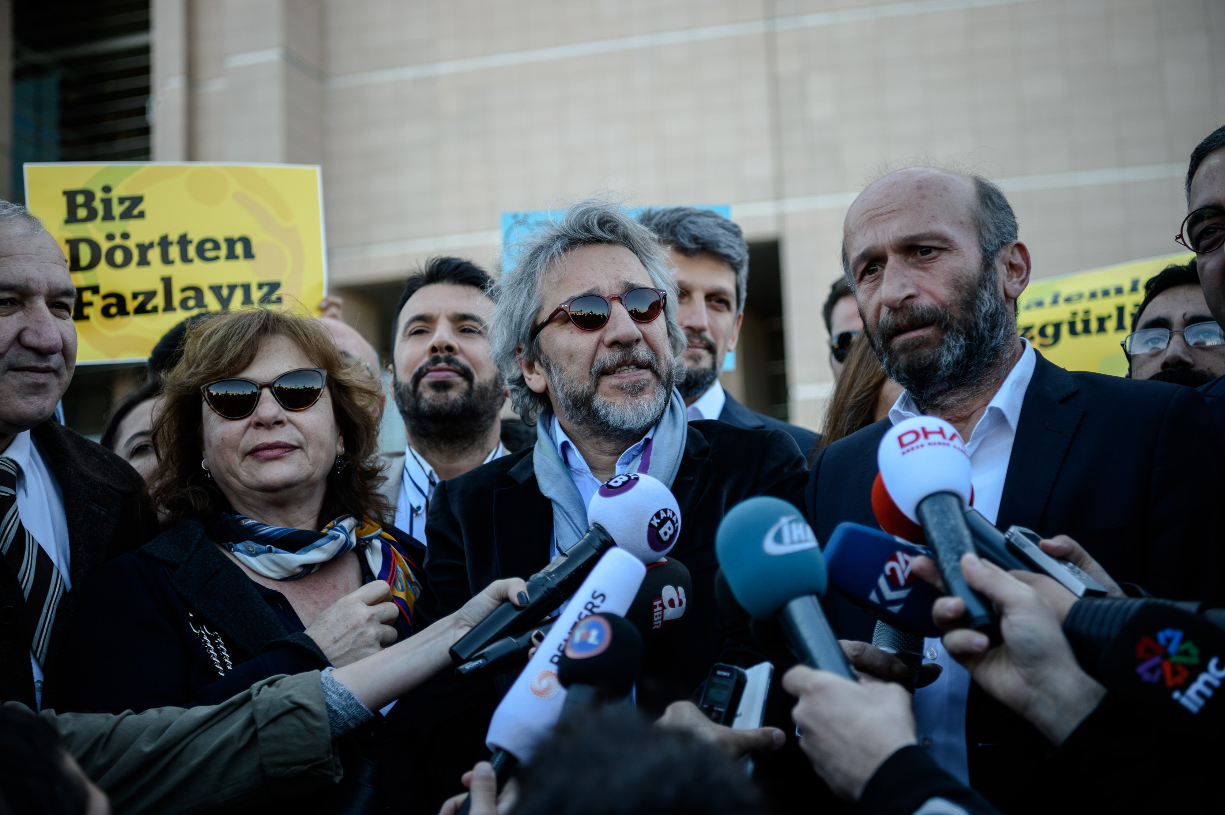 Editor-in-chief of Turkish newspaper Cumhuriyet daily Can Dundar (C) and the newspaper bureau chief in Ankara Erdem Gul (R) arrive to the Istanbul courthouse for their trial on April 22, 2016 in istanbul.   Cumhuriyet daily's editor-in-chief Can Dundar and Ankara bureau chief Erdem Gul face possible life terms on spying charges over a news report accusing President Recep Tayyip Erdogan's government of seeking to illicitly deliver arms bound for neighbouring Syria. / AFP / OZAN KOSE        (Photo credit should read OZAN KOSE/AFP/Getty Images)