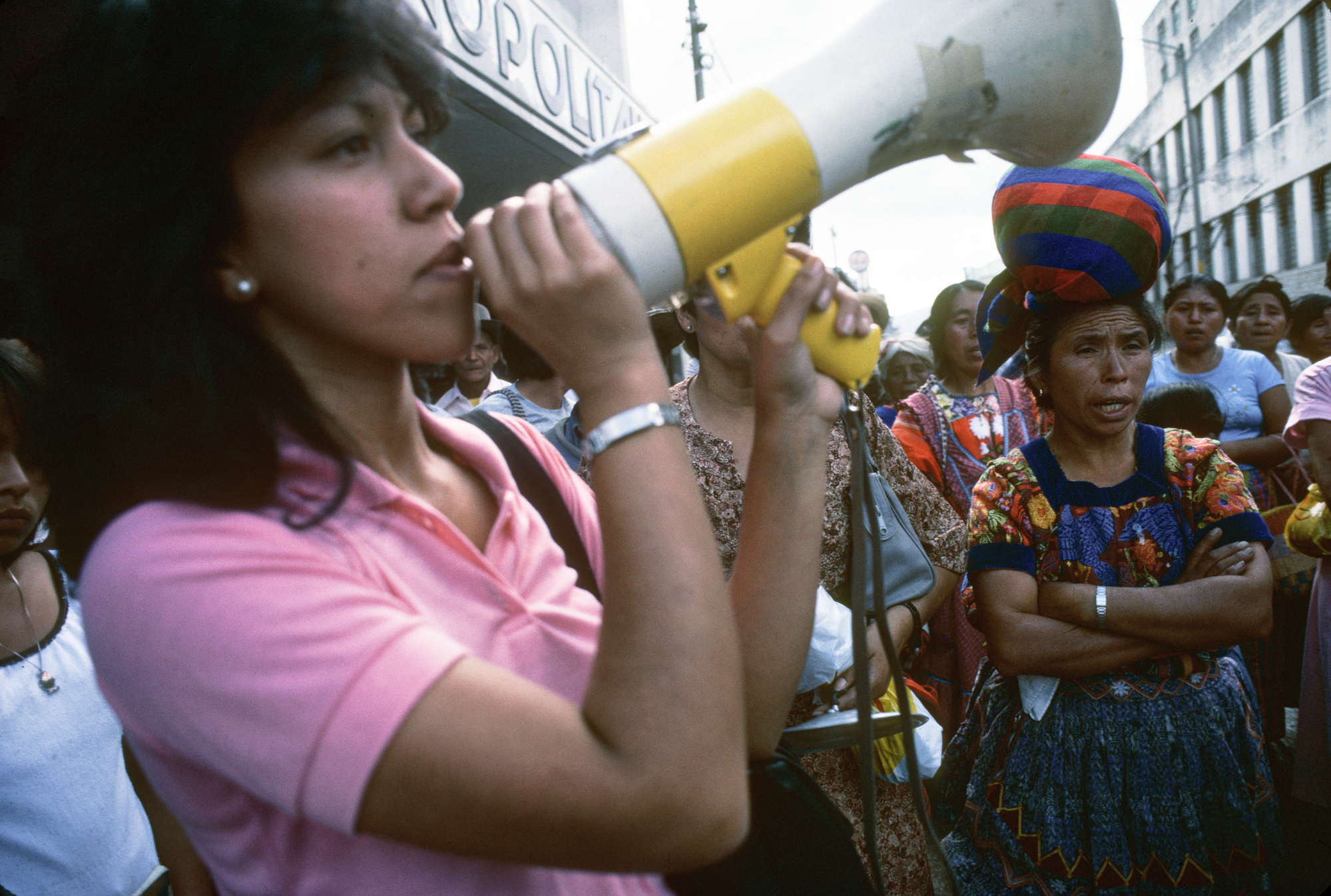 "Rosario Godoy de Cuevas speaks into a megaphone at a demonstration at a GAM in Guatemala, 1985.  Grupo de Apoyo Mutuo (GAM; Mutual Support Group) support group for families whose relatives had ""disappeared""."