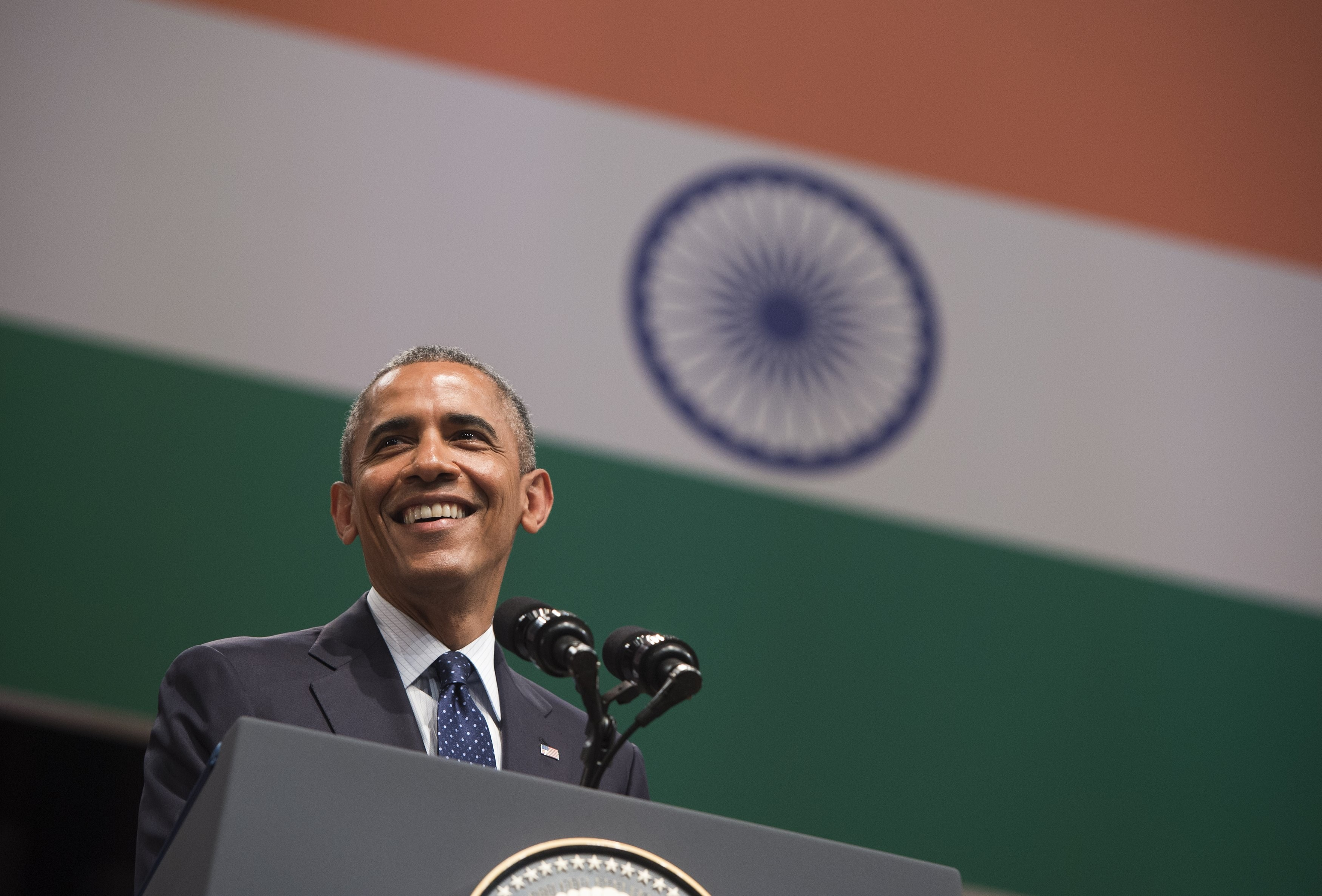 "US President Barack Obama speaks on US - India relations during a townhall event at Siri Fort Auditorium in New Delhi on January 27, 2015. US President Barack Obama warned January 27 that the world does not ""stand a chance against climate change"" unless developing countries such as India reduce their dependence on fossil fuels. AFP PHOTO / SAUL LOEB        (Photo credit should read SAUL LOEB/AFP/Getty Images)"