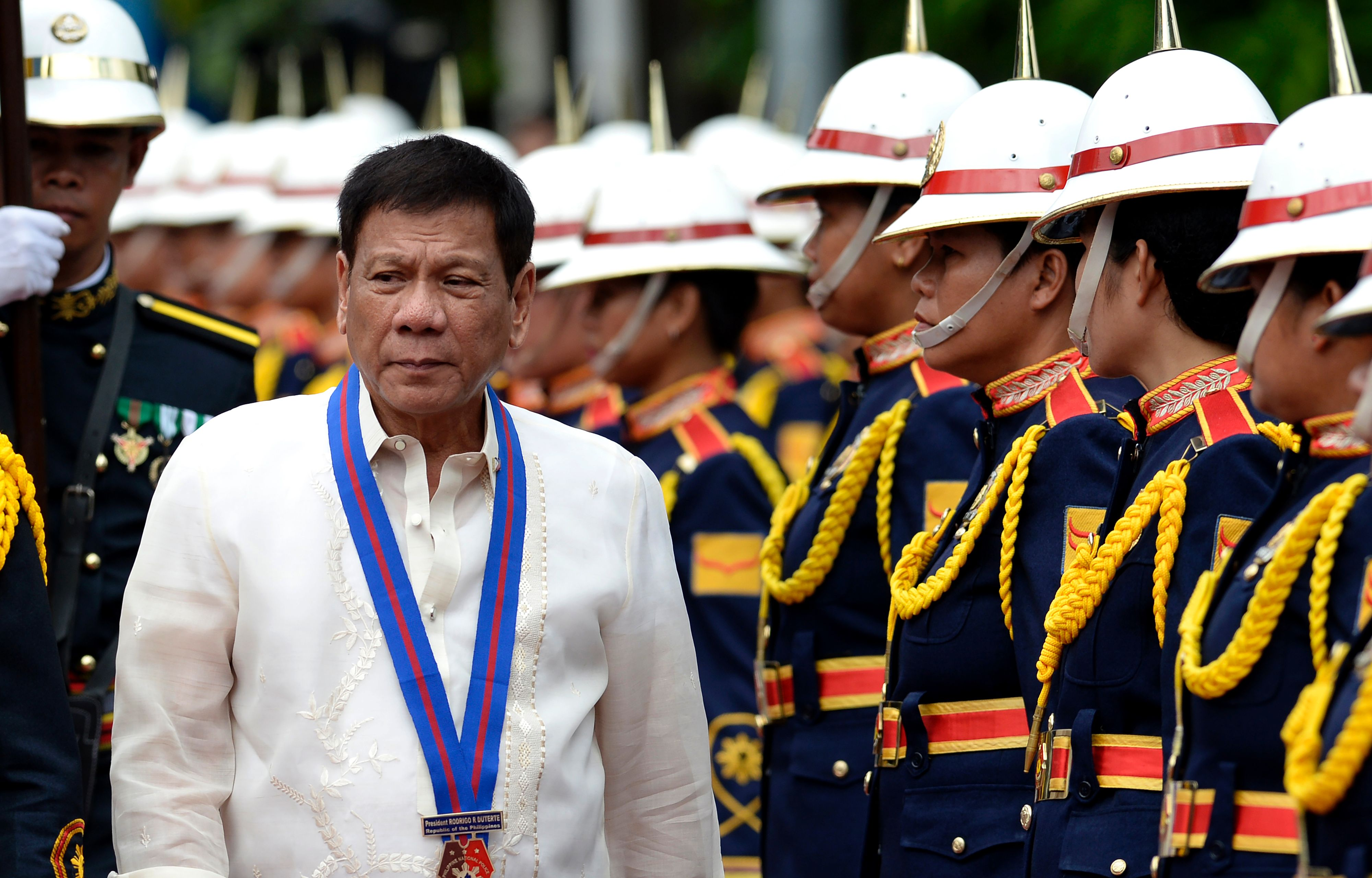 Philippine President Rodrigo Duterte walks past honour guards before Philippine National Police (PNP) chief Ronald Bato Dela Rosa's Assumption of Command Ceremony at the Camp Crame in Manila on July 1, 2016.  Authoritarian firebrand Rodrigo Duterte was sworn in as the Philippines' president on June 30, after promising a ruthless and deeply controversial war on crime would be the main focus of his six-year term. / AFP / NOEL CELIS        (Photo credit should read NOEL CELIS/AFP/Getty Images)