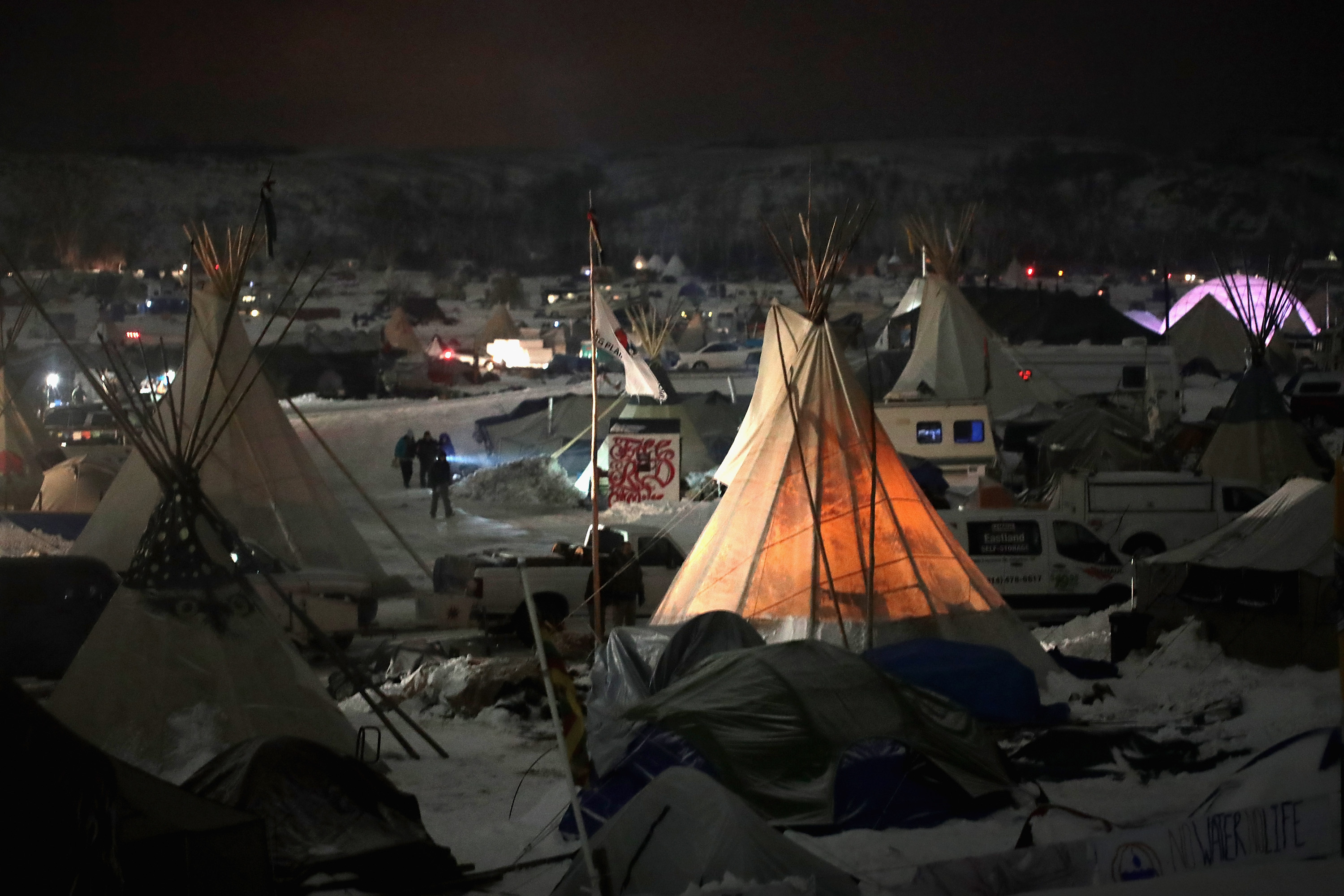CANNON BALL, ND - DECEMBER 01:  Night falls on Oceti Sakowin Camp on the edge of the Standing Rock Sioux Reservation on December 1, 2016 outside Cannon Ball, North Dakota. Native Americans and activists from around the country have been gathering at the camp for several months trying to halt the construction of the Dakota Access Pipeline. The proposed 1,172-mile-long pipeline would transport oil from the North Dakota Bakken region through South Dakota, Iowa and into Illinois.  (Photo by Scott Olson/Getty Images)